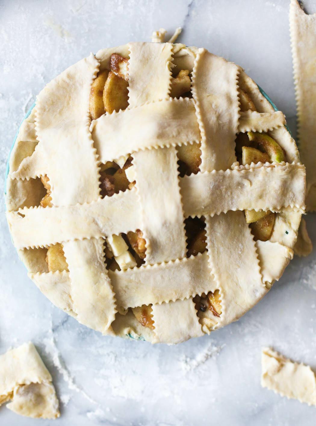 apple pie with lattice top crust before baking