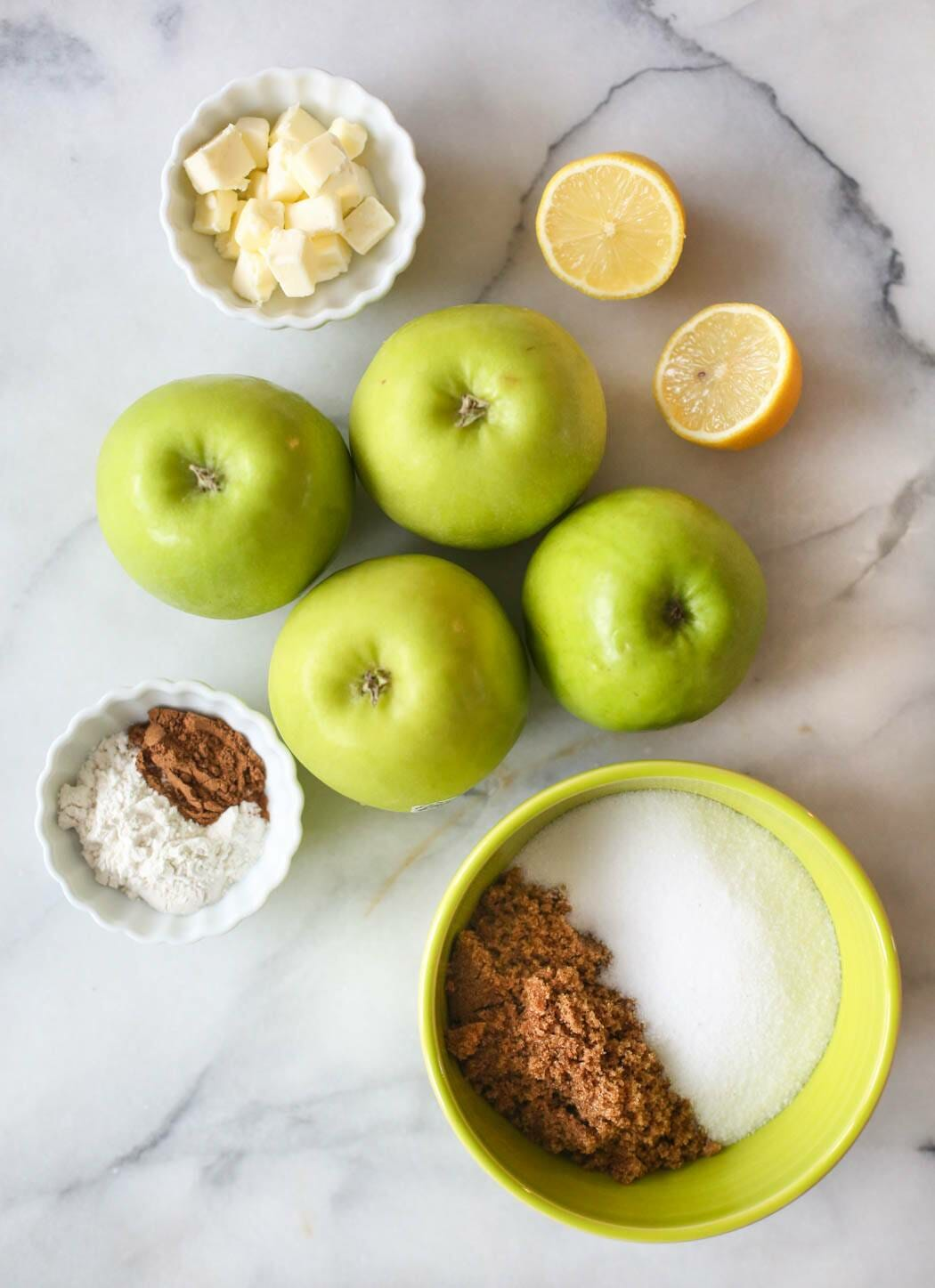 Ingredients for apple pie on a marble slab