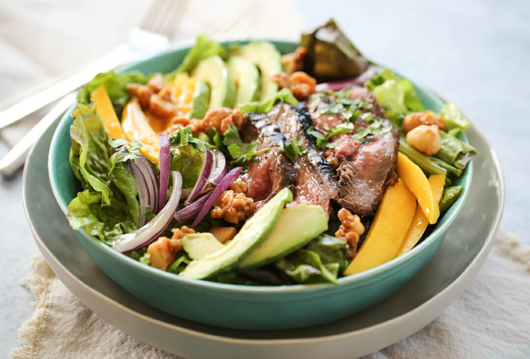 Steak and Mango Salad in serving bowl