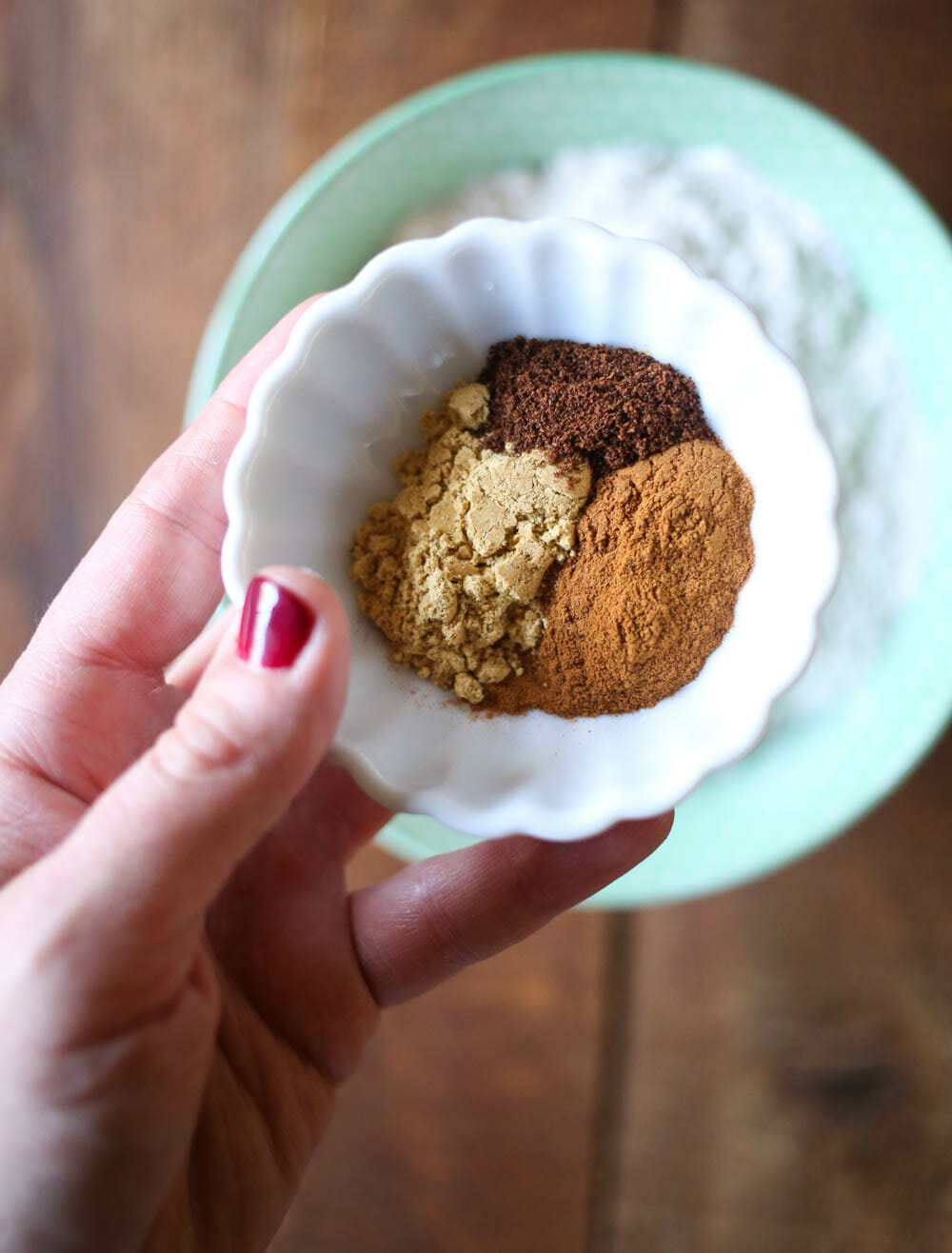 adding spices to ginger spice cookies