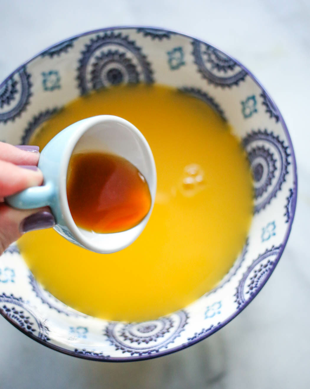 adding extracts to orange juice and sugar