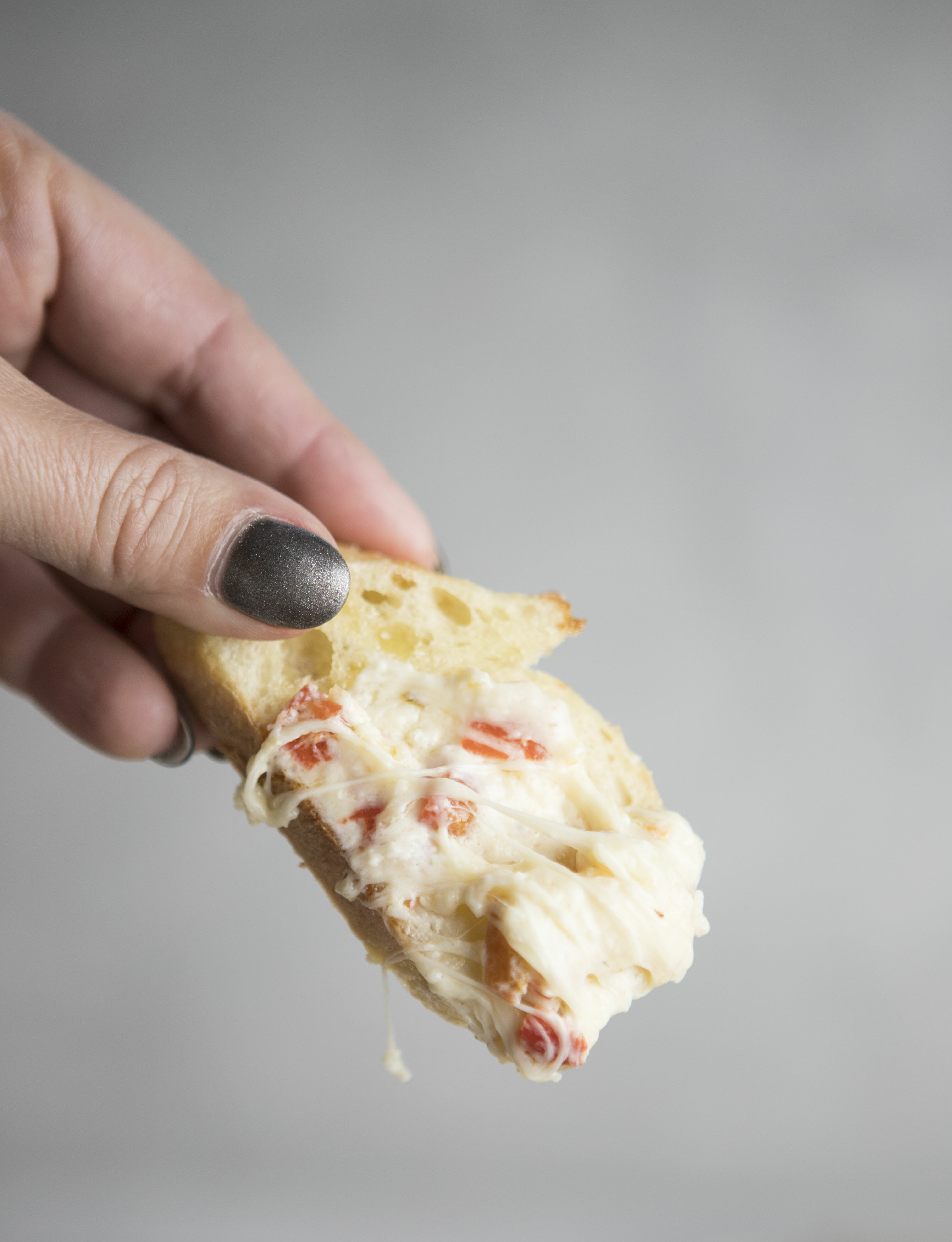 Roasted Red Pepper Dip on a baguette