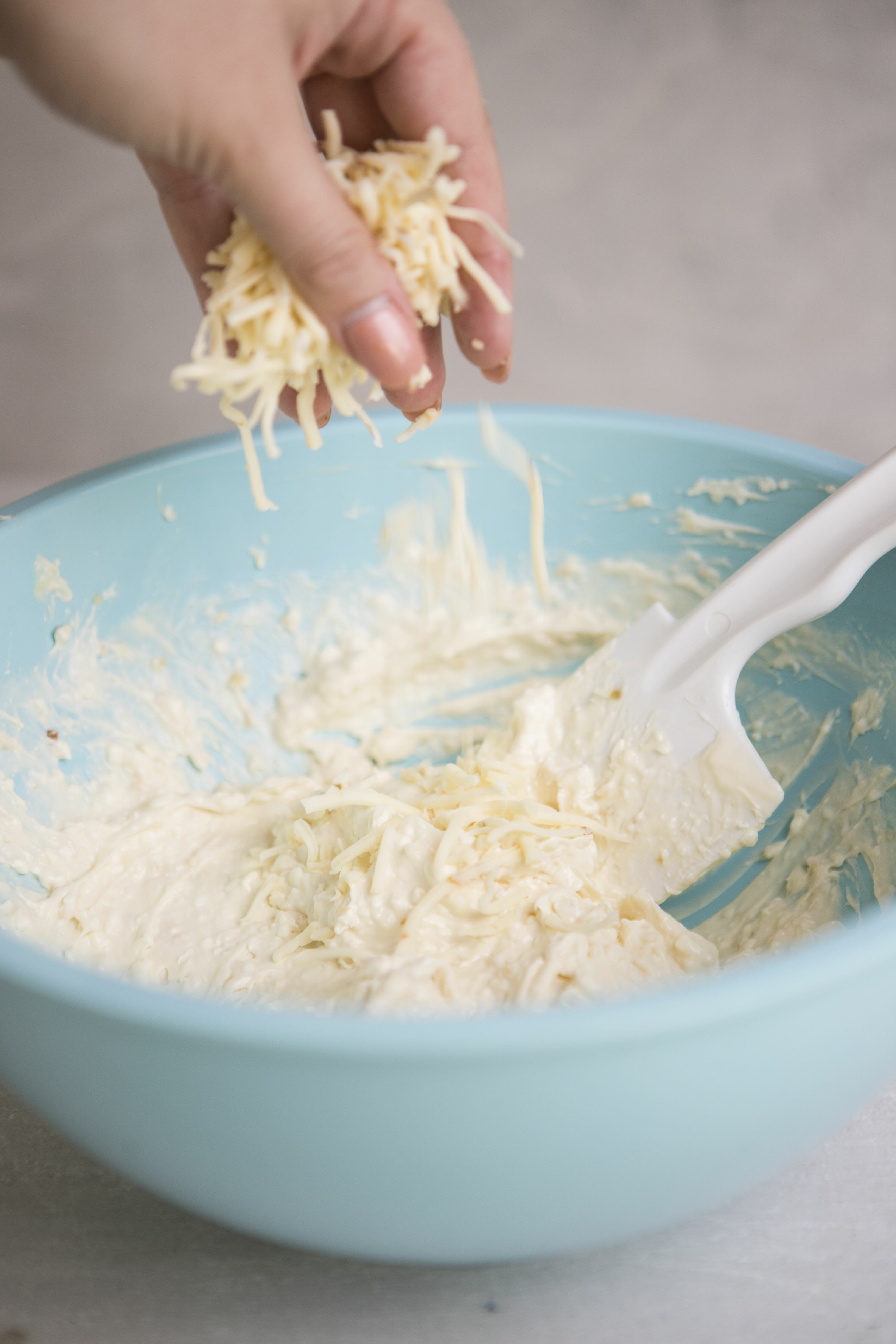 adding grated cheese