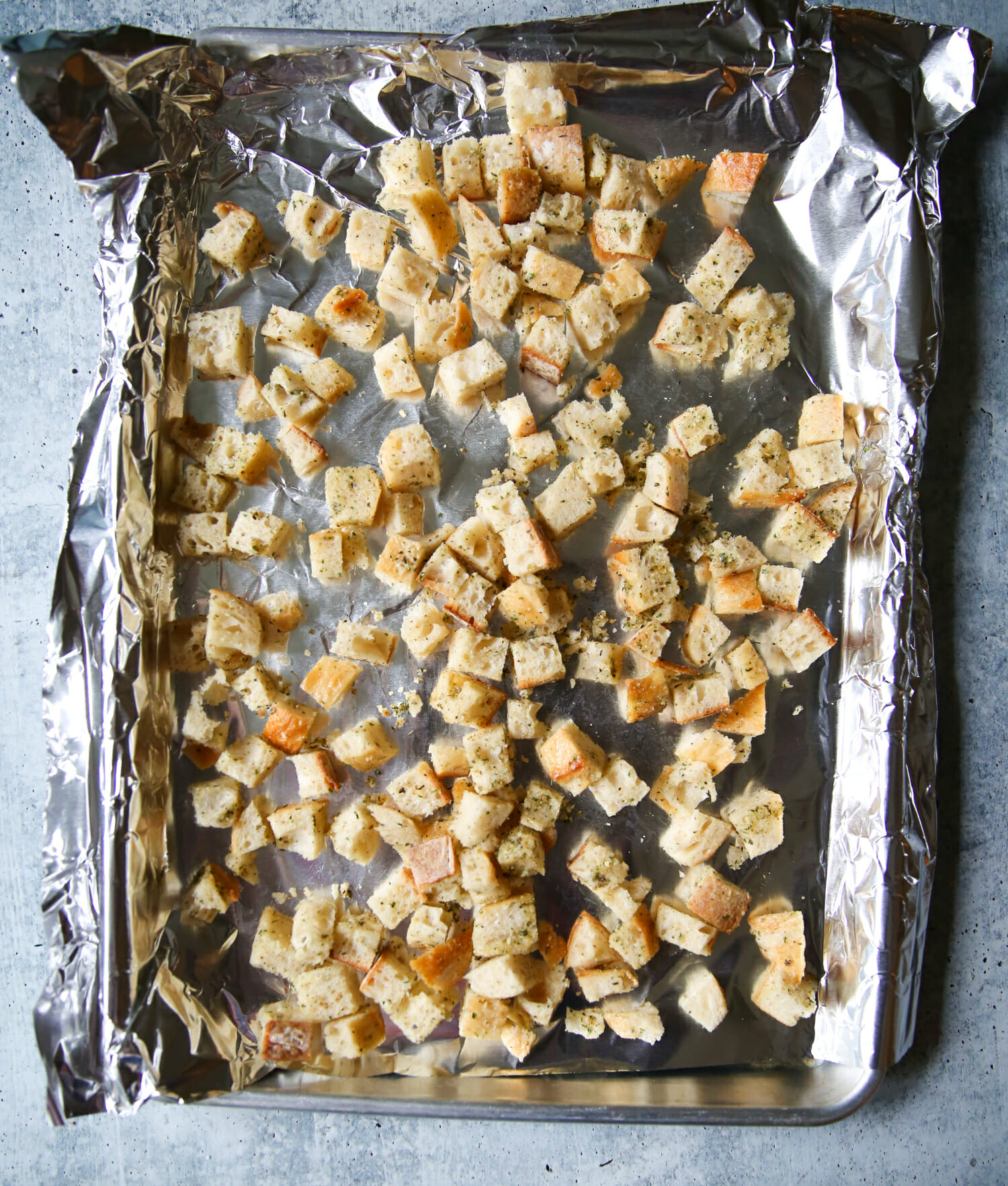 baking homemade sourdough garlic-herb croutons from our best bites