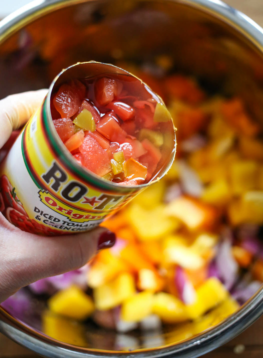 adding canned tomatoes to southwestern beef wraps