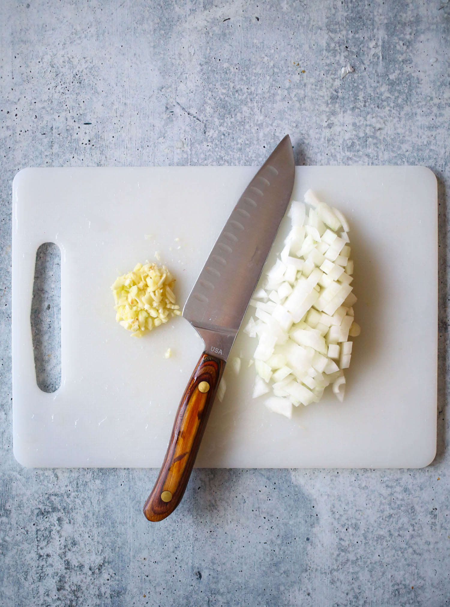 chopped garlic and onion for chicken pot pie from our best bites