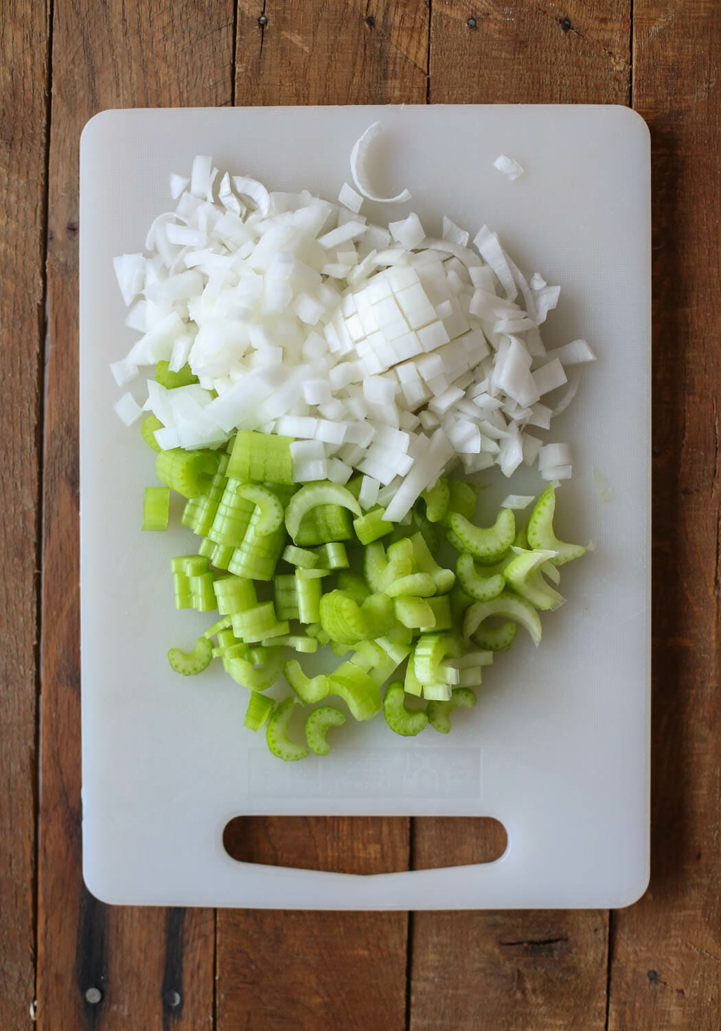 chopped onion and celery for Italian Sausage Thanksgiving Dressing