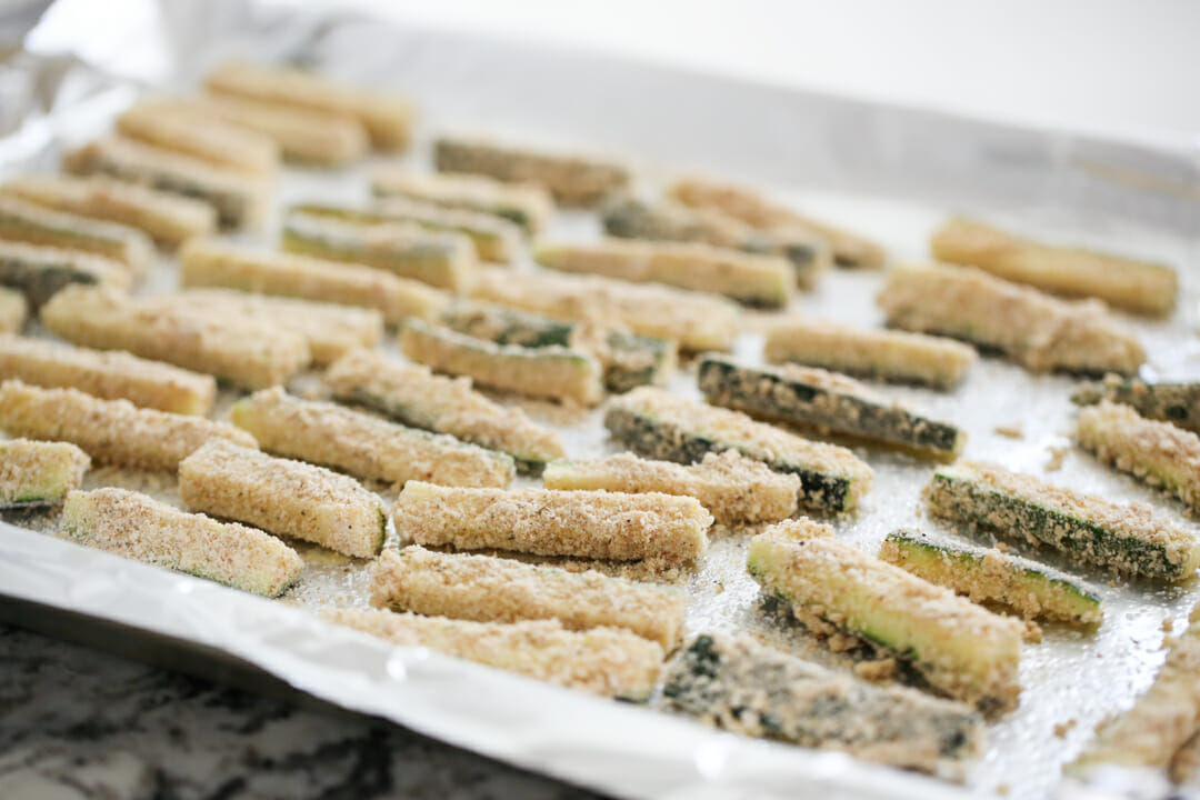 Zucchini Fries ready for baking on pan