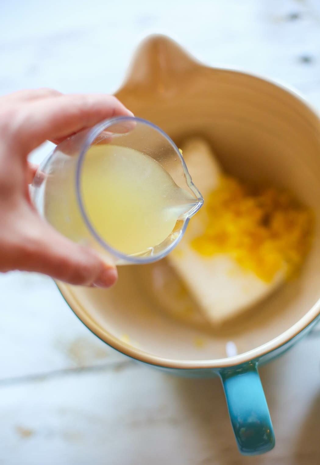 adding lemon juice to Overnight Cream Cheese Stuffed Lemon French Toast with Strawberries