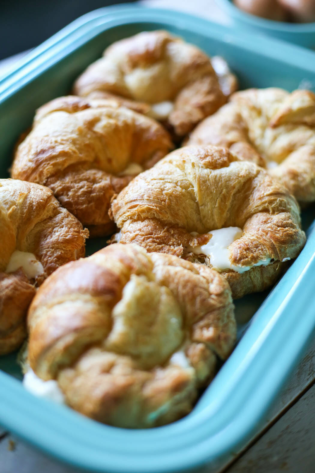 cream cheese stuffed croissants in baking dish