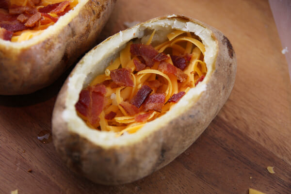 bacon and shredded cheese inside baked potatoes