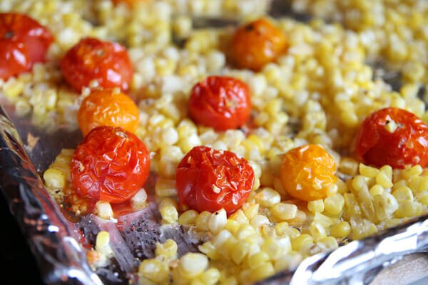 Take the corn and tomatoes out of the oven when your tomatoes look all ...