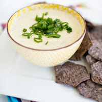 White queso dip with salsa verde, garlic, and lime from Our Best Bites