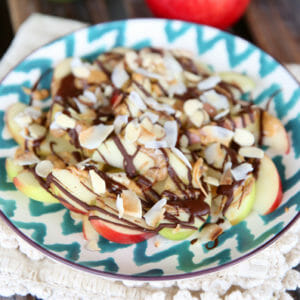 Chocolate-Peanut Butter Apples with Almonds & Coconut on a plate