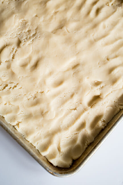 pressed dough in baking sheet
