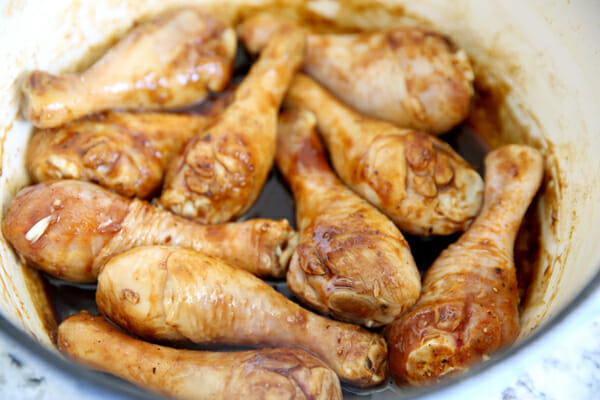 Browning drumsticks with sauce