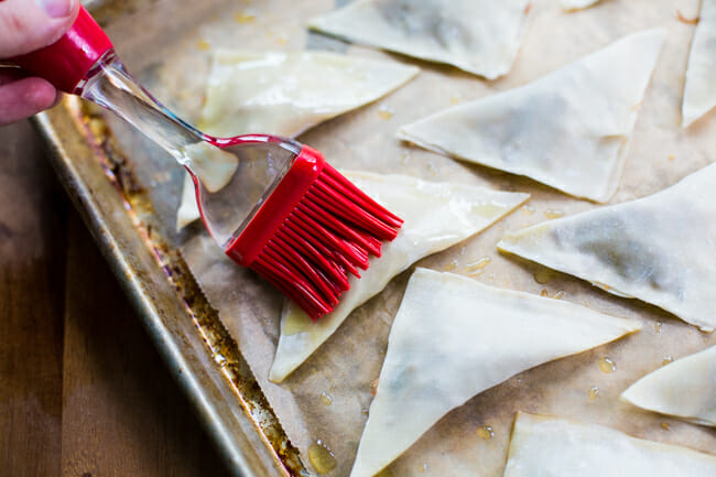 brushing wontons with garlic olive oil