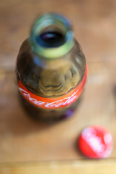 Bottle of Coke for sweet and smokey cola BBQ sauce