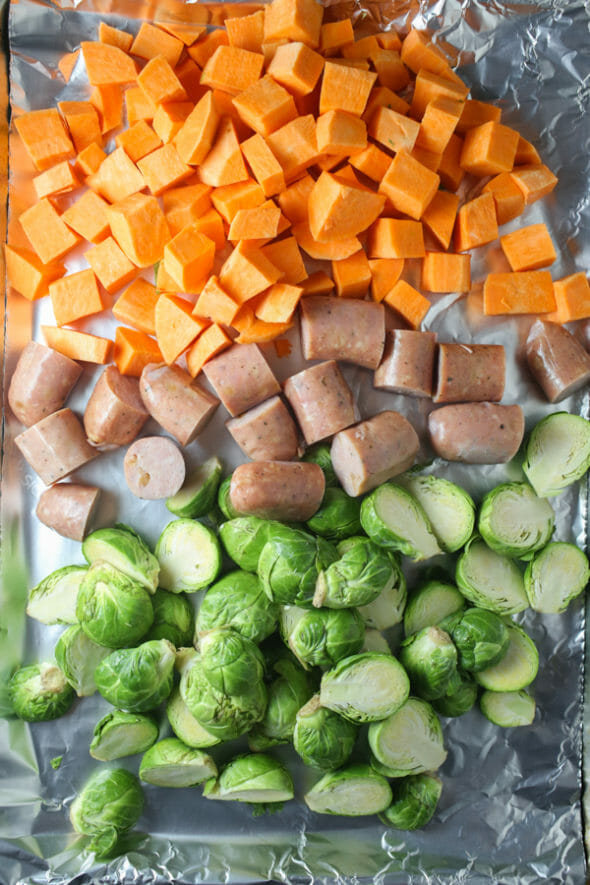 Quick, Easy, and Healthy single sheet pan dinner with roasted chicken sausage, Brussels sprouts, and sweet potatoes