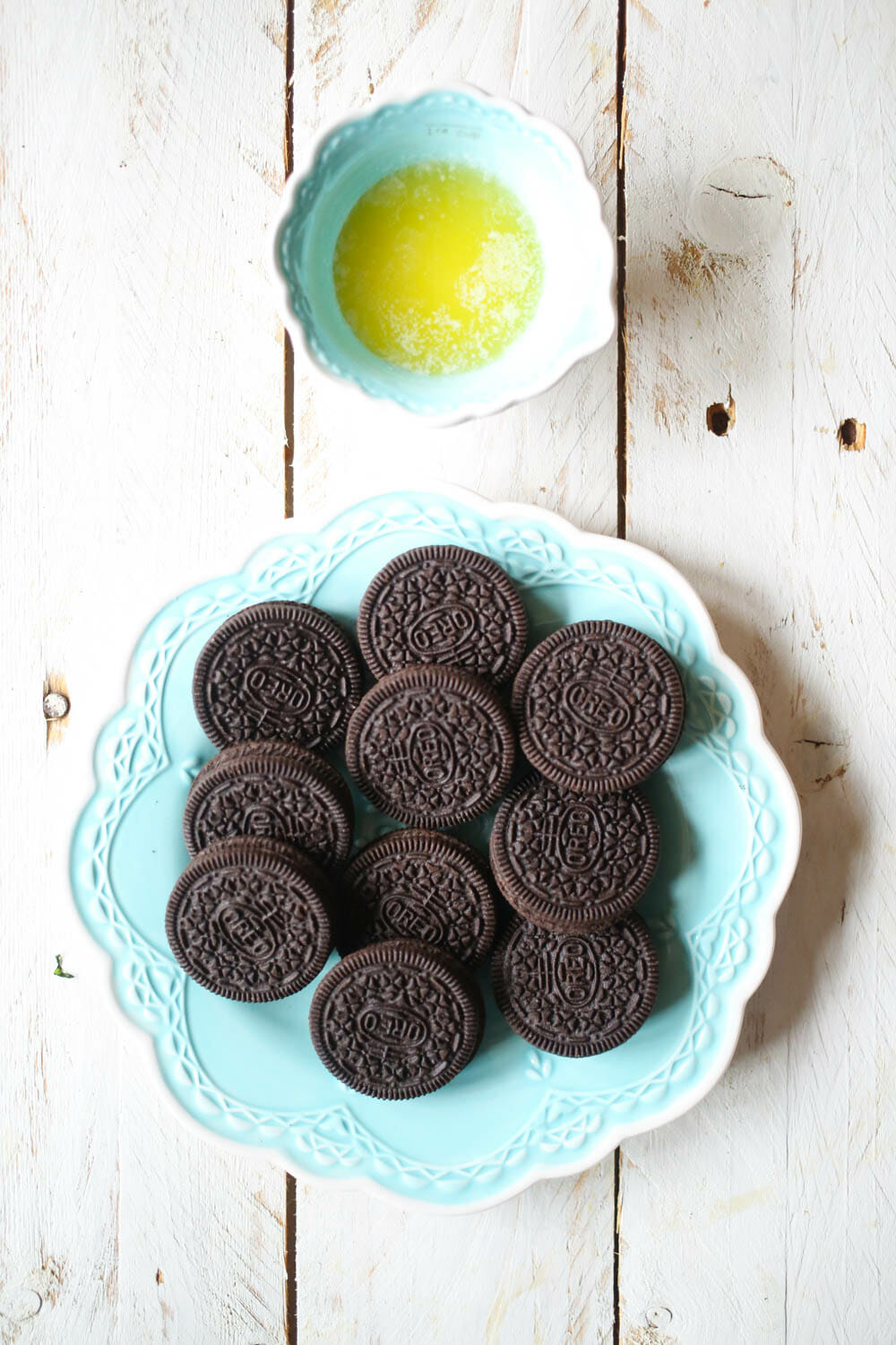Oreos and butter for Mini Peppermint Chocolate Cheesecakes from Our Best Bites