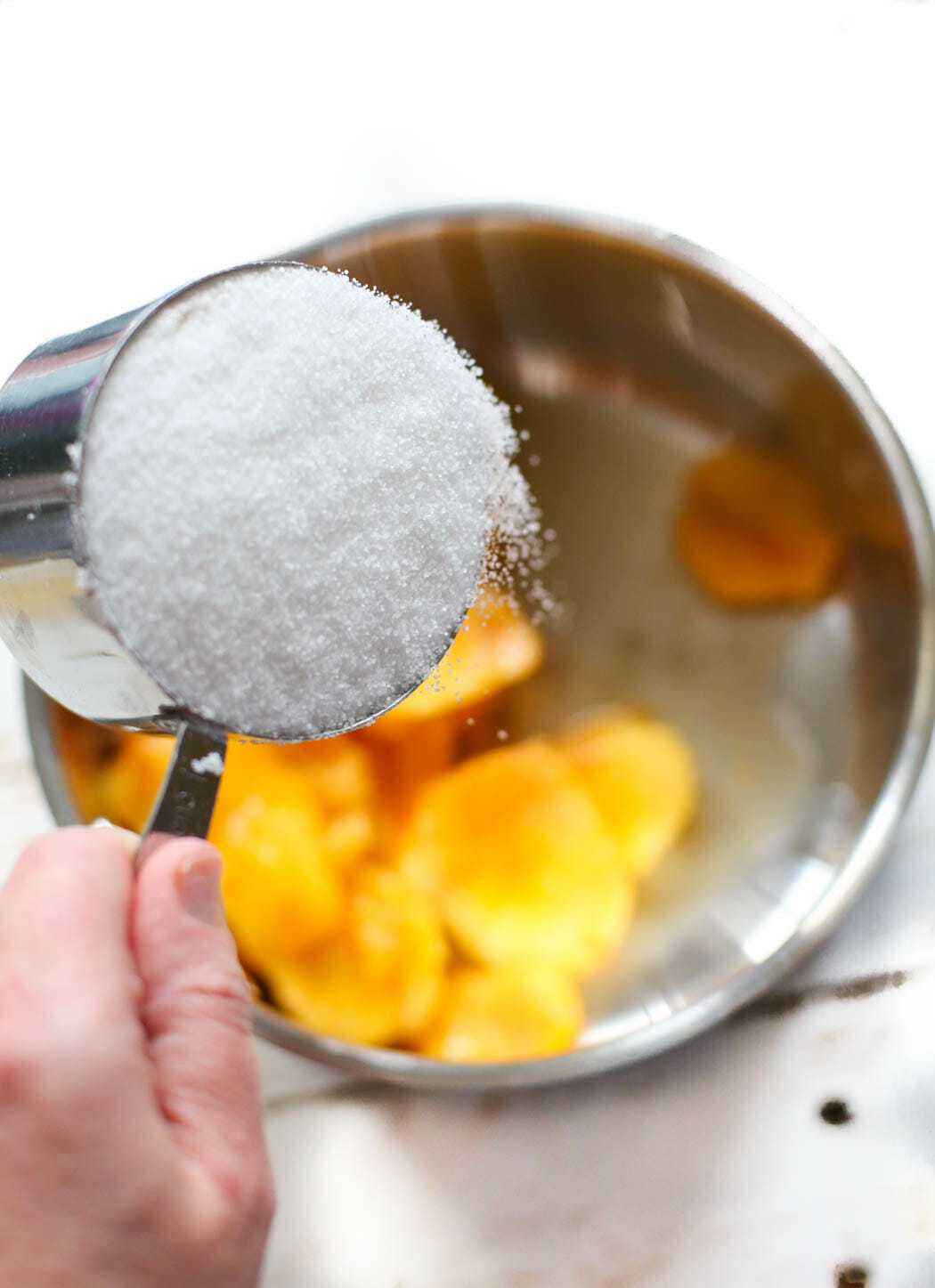 adding sugar to peaches for peach syrup
