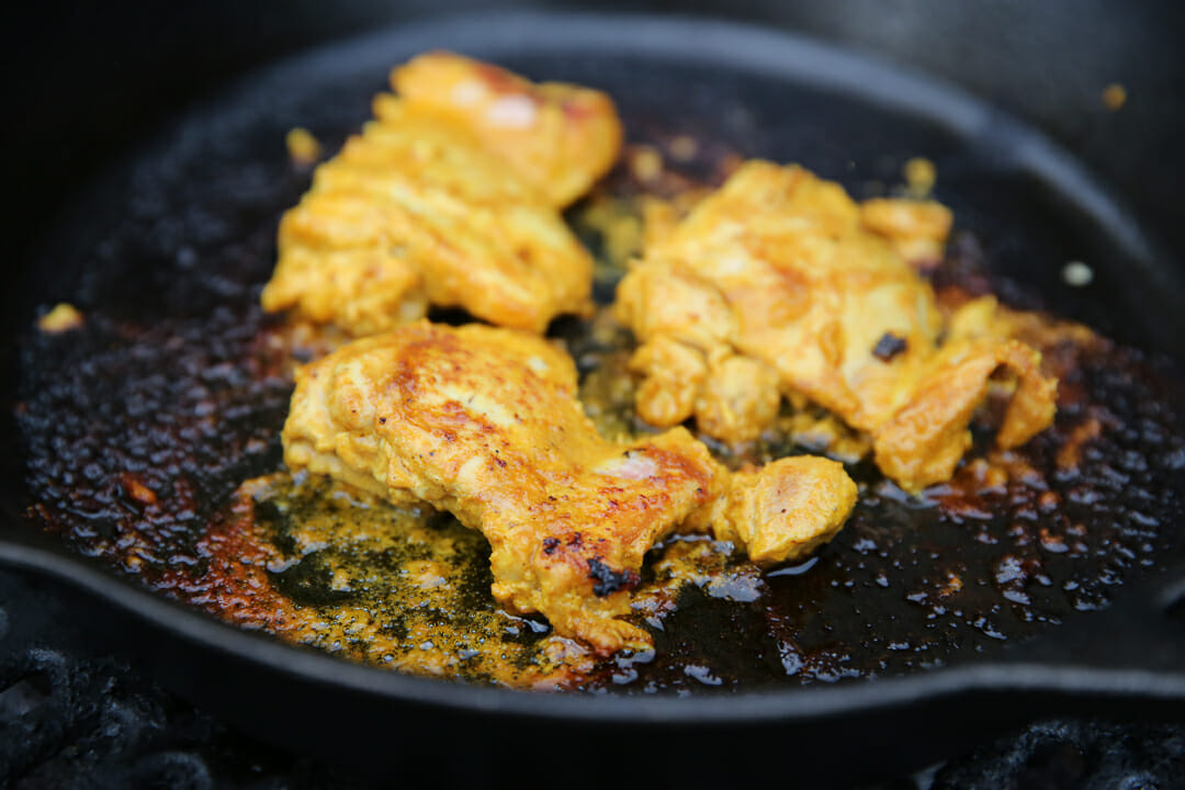 Tandoori Chicken Cooking in Skillet