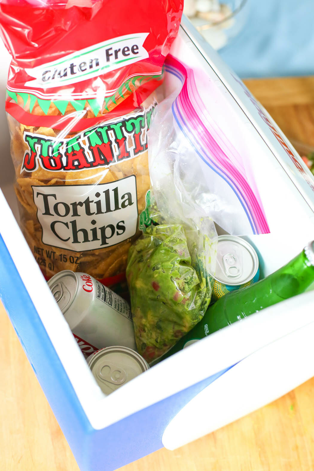 Guacamole chips drinks in cooler