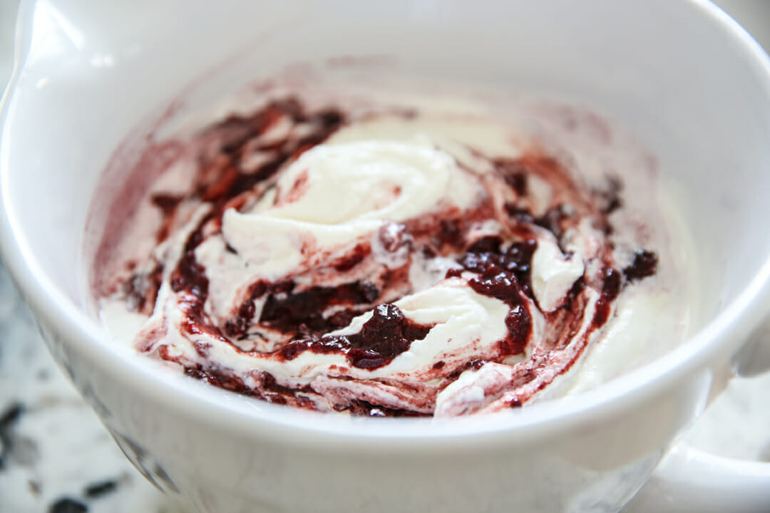 mixing cherries with ice cream batter