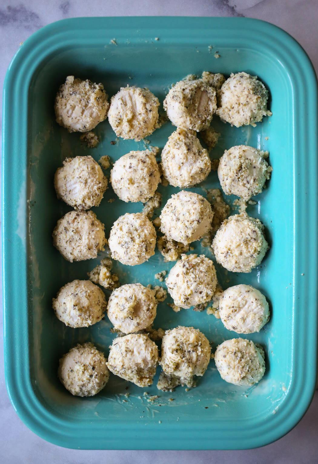 seasoned dough balls in a pan