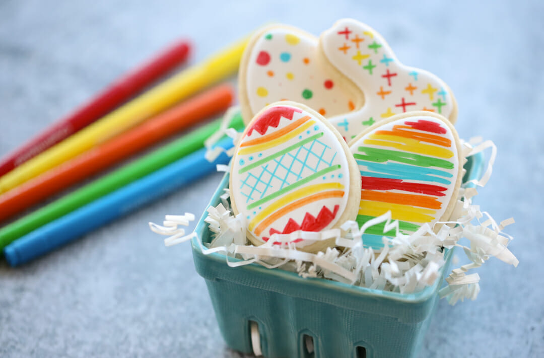 rainbow easter cookies in basket
