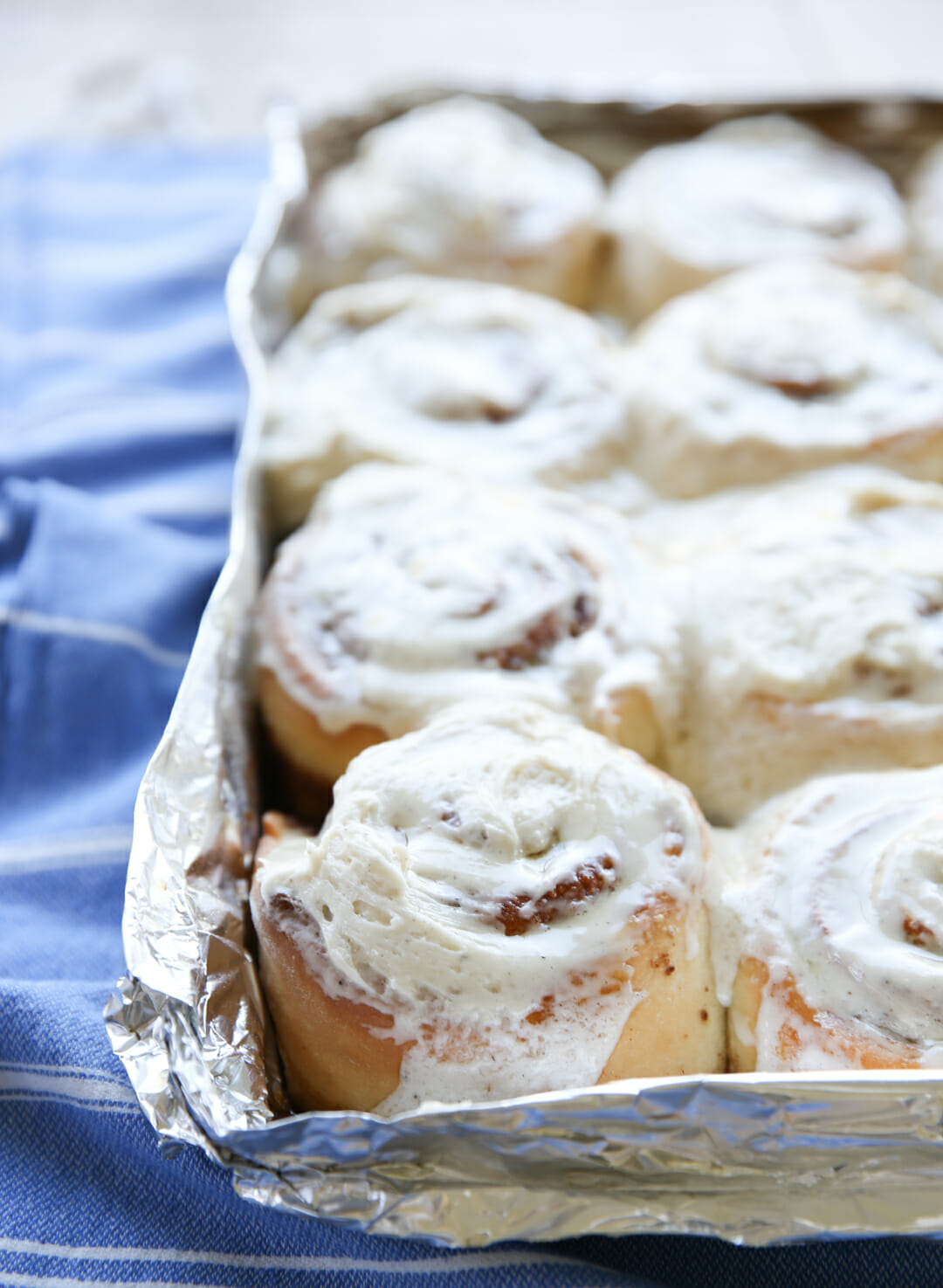 The best cinnamon Rolls with frosting in pan