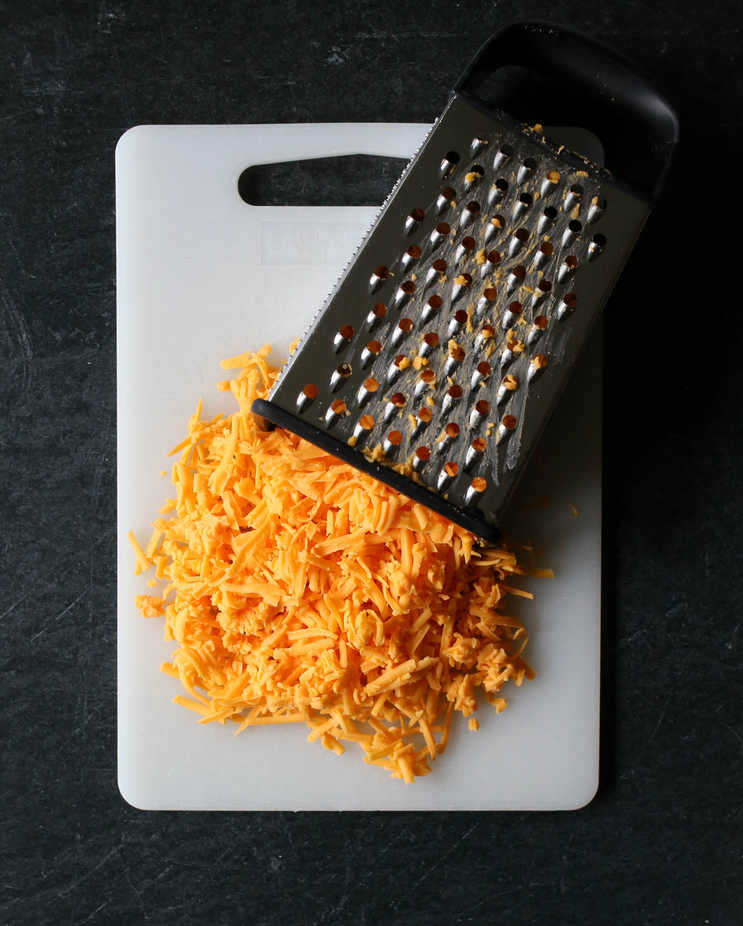 grated cheese for cheeseburger macaroni from our best bites
