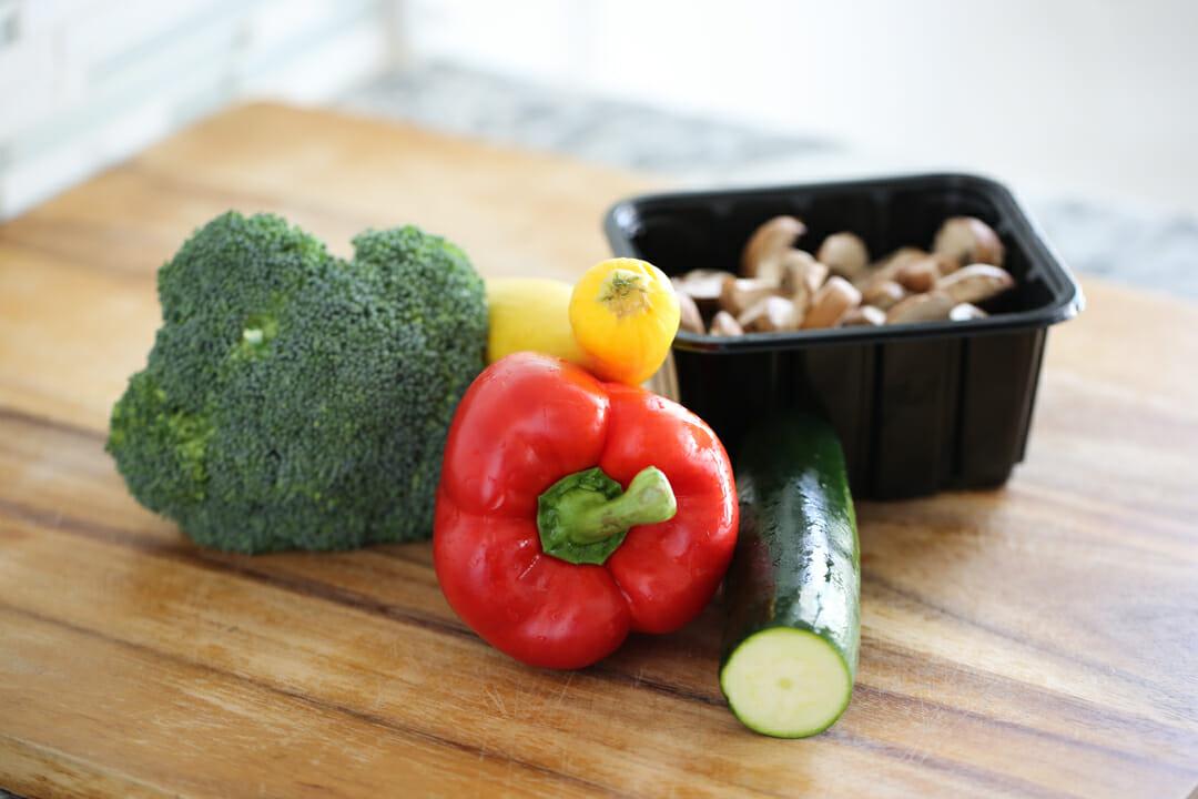 fresh veggies on cutting board