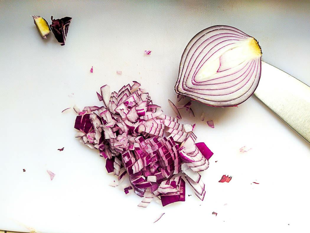 dicing onion on cutting board