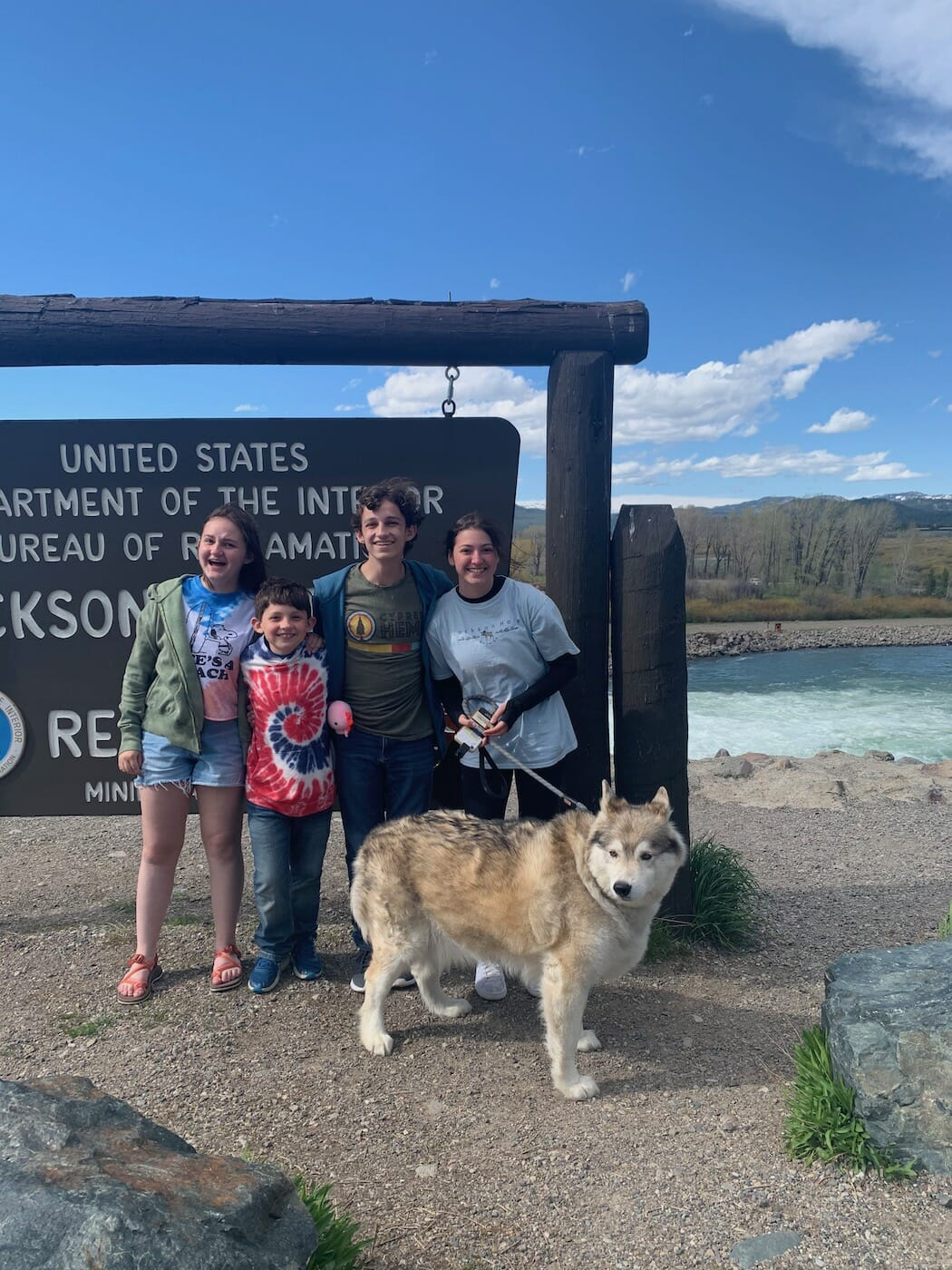 kids in front of Jackson Dam with a dog