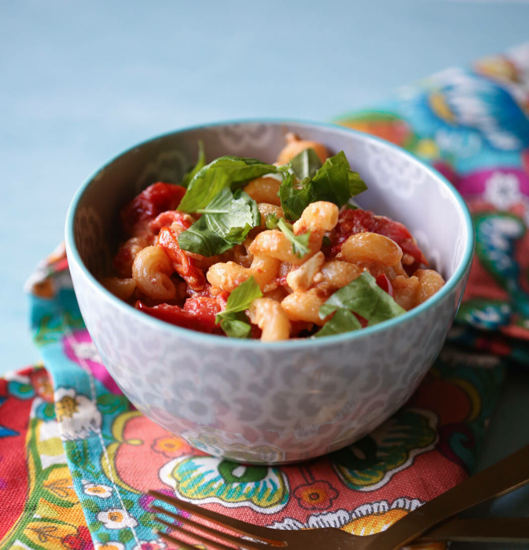 fresh tomato and feta pasta in a bowl from our best bites