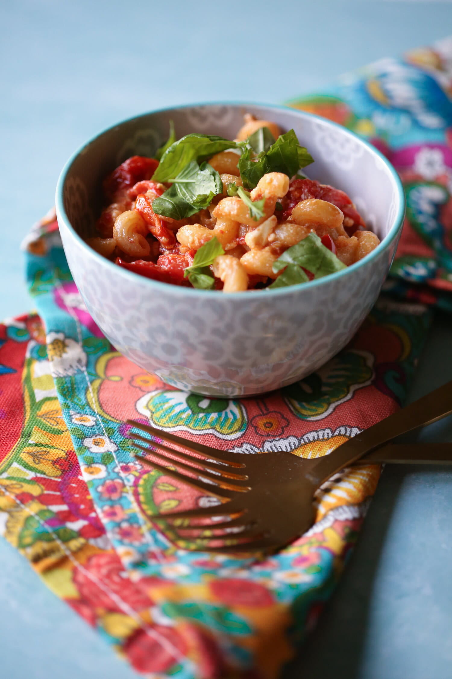 TikTok Pasta - Fresh tomatoes and feta - in a bowl topped with basil