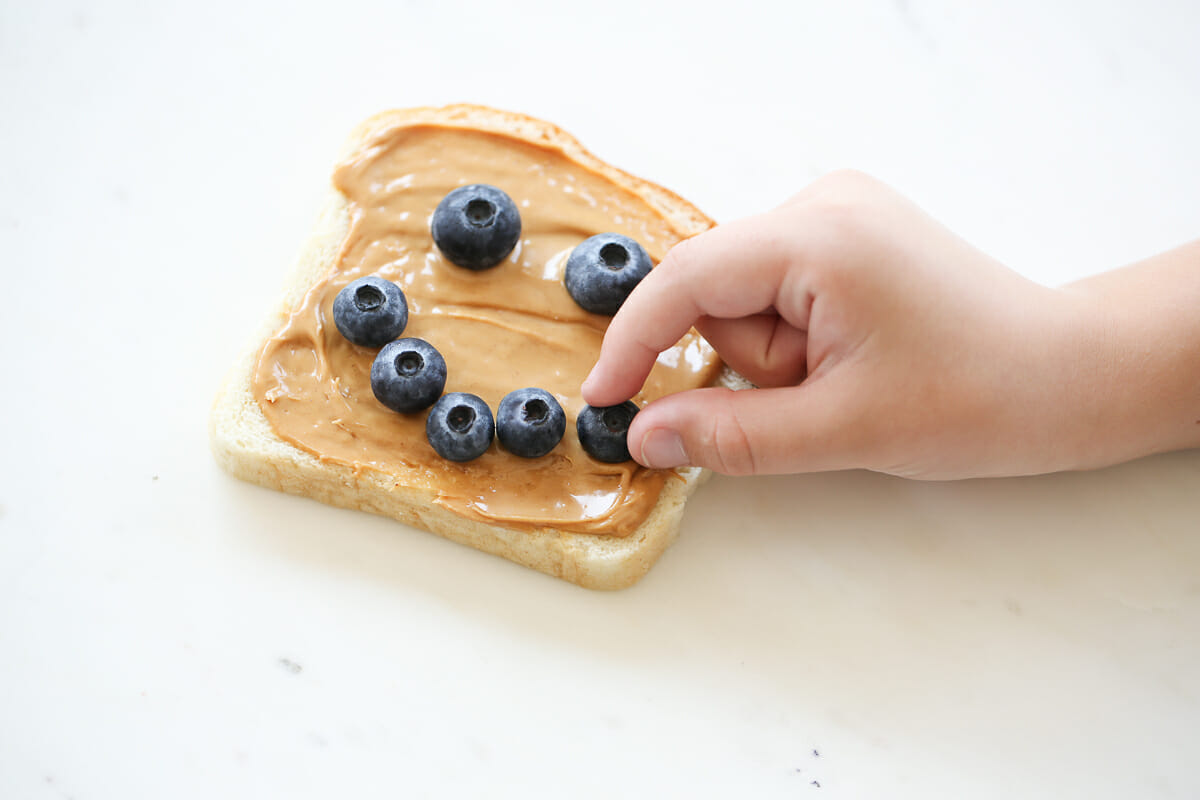 peanut butter toast with blueberries